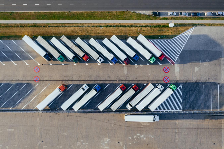 Pangea IoT blog: Roaming IoT SIM - Showing lorries parked