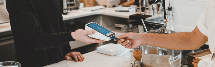 Pangea IoT news: Person buying from mobile ePOS in the carribean