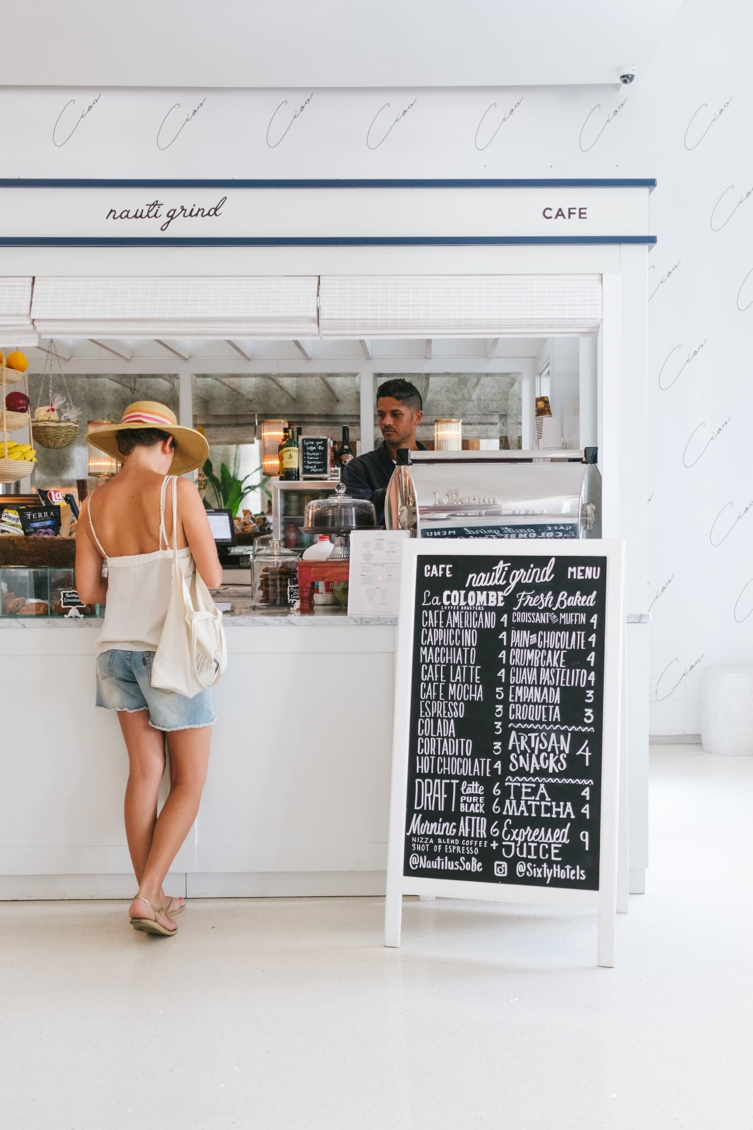 Pangea IoT blog: Woman buying from mobile ePOS in the Caribbean